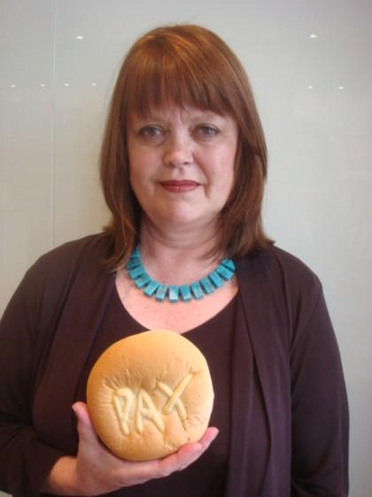 Lizzie Davies holding 'PAX Bread'