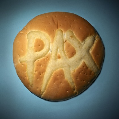 Photograph of a round bread with PAX written on it